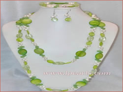 white side-drilled pearl jewelry set with green coin shells