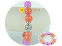 "7.5"" gemstone bracelet in fresh orange and purple"