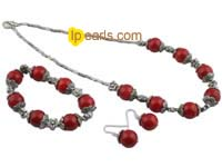 Stylish red coral and flower spacers Necklace and bracelet set