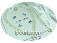 different sizes of white pearl necklace set